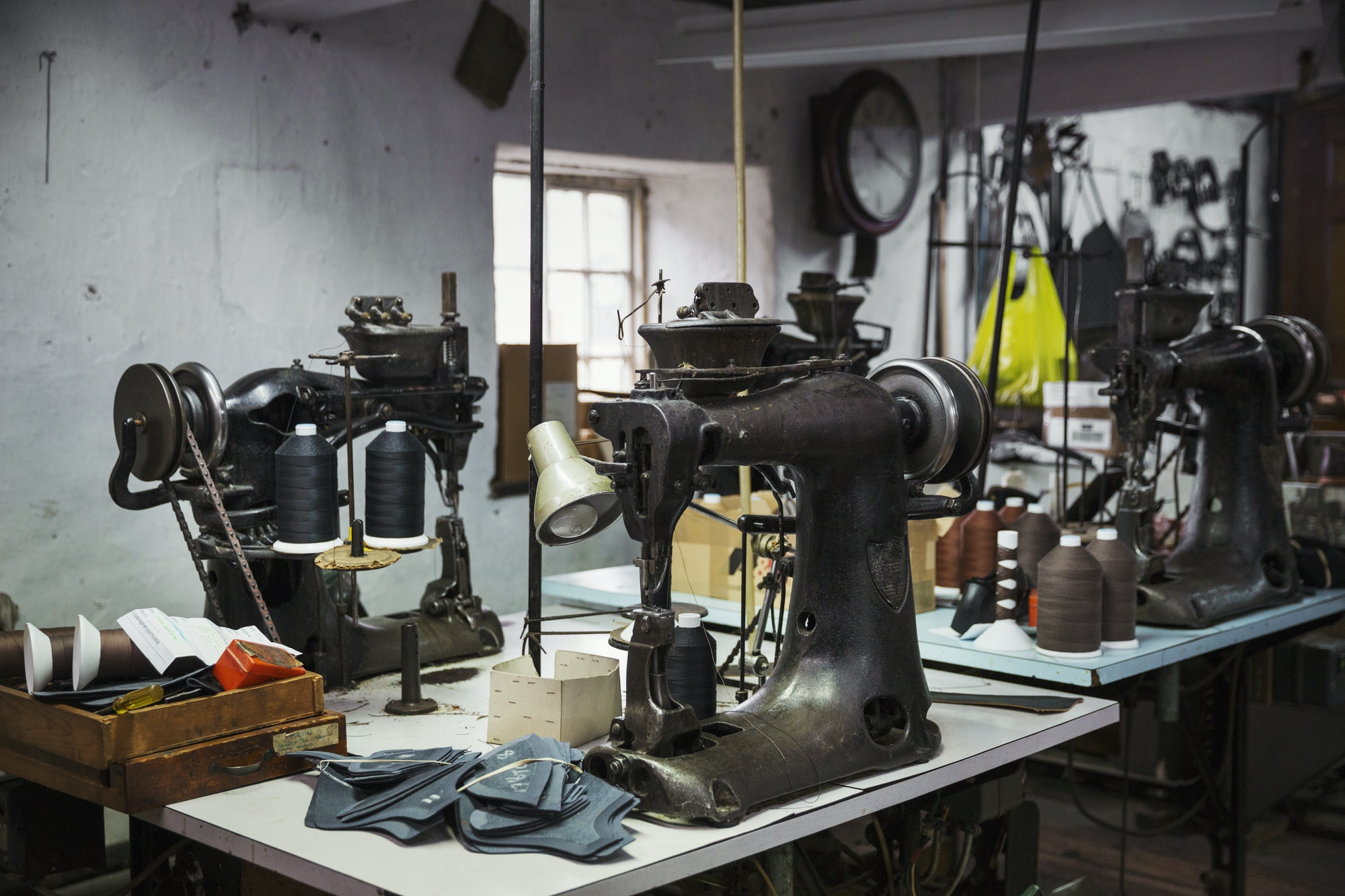 Sewing machines in a shoemaker's workshop.